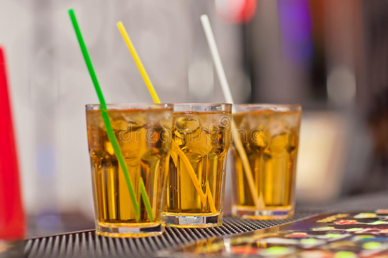 Three glasses with a refreshing drink. On bar counter stock photography