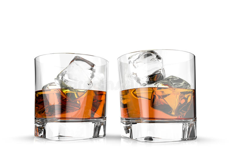 Three glasses of whiskey with ice cubes isolated on a white background. stock image