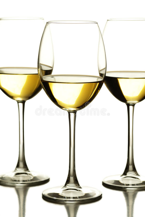 Three glasses of white wine royalty free stock images