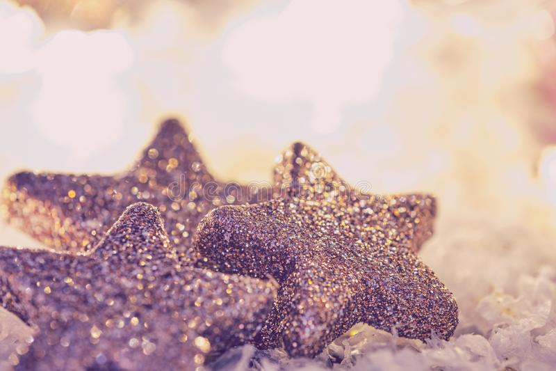 Three glittery stars with bright background in matt look with copy space stock photo