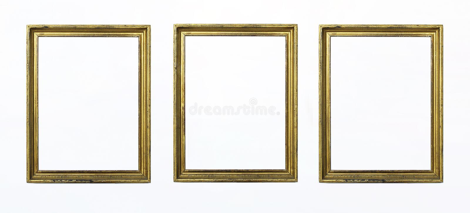 Three gold rectangular frames for painting or picture on white background. Isolated. Add your text. royalty free stock images