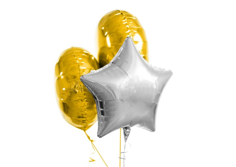 Three gold and silver helium balloons on white. Holidays and birthday party decoration concept - three metallic gold and silver helium balloons of different stock photo