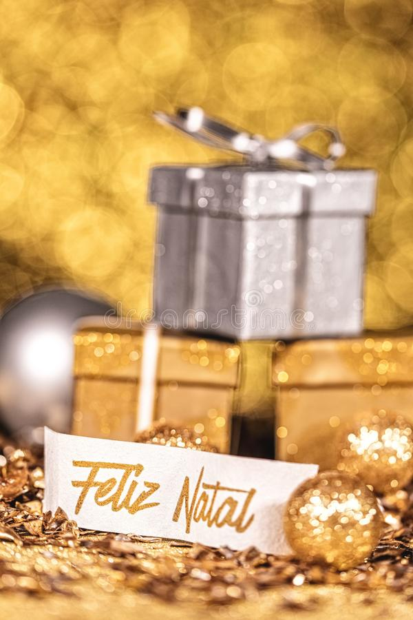 Gifts with portuguese text which means merry christmas stock photo
