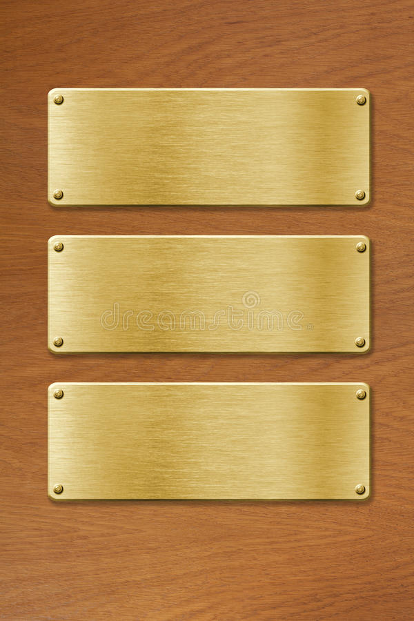 Download Three Golden Metal Plates Over Wood Texture Background Stock Photo - Image: 29104876