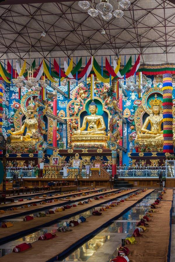 Three golden statues inside Vihara at Namdroling Buddhist Monastery, Coorg India. royalty free stock photography
