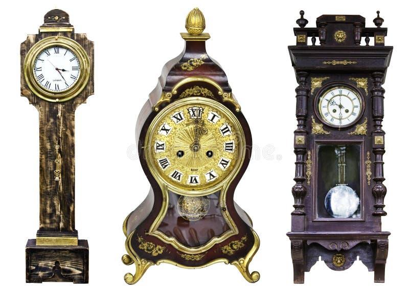 Three golden vintage clocks isolated stock image