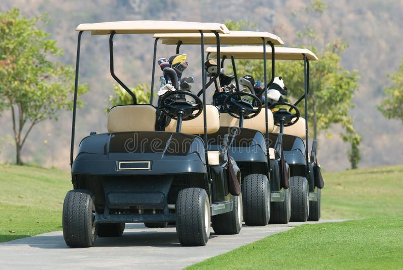 Three golf cars royalty free stock image