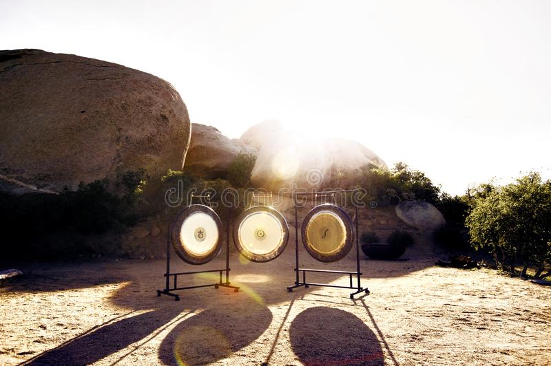 Sound Healing Gongs. Gongs waiting to be played. The Gong is one of man's most powerful and oldest transformational and therapeutic instruments. It has stock images