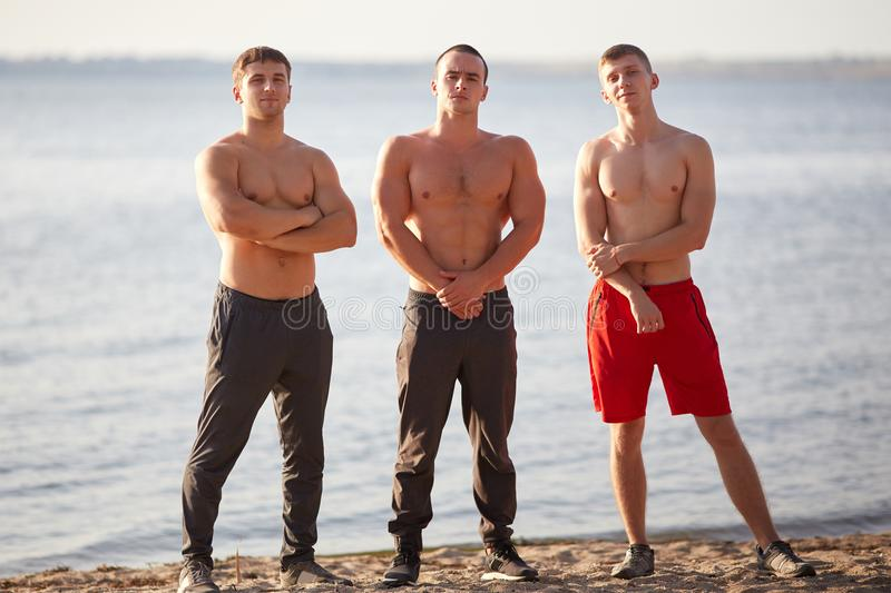 shirtless young bodybuilders on a river background. Healthy lifestyle concept. stock photography