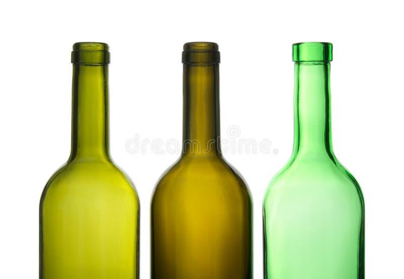 Three green empty wine bottles royalty free stock image