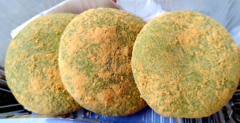 Three green mochi cakes royalty free stock photos