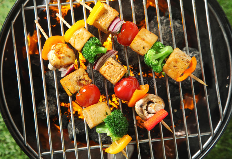 Three grilled tofu or bean curd kebabs stock photography