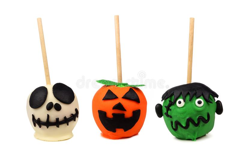Three unique Halloween candy apples isolated on white royalty free stock image