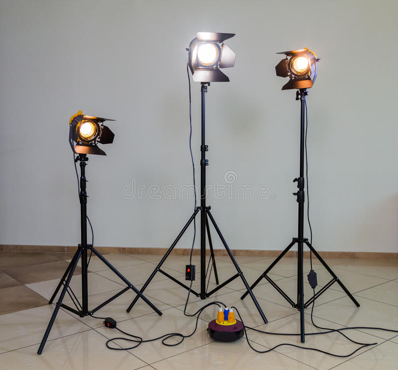 Three halogen spotlights with Fresnel lenses on a grey background. Photographing and filming in the interior stock images