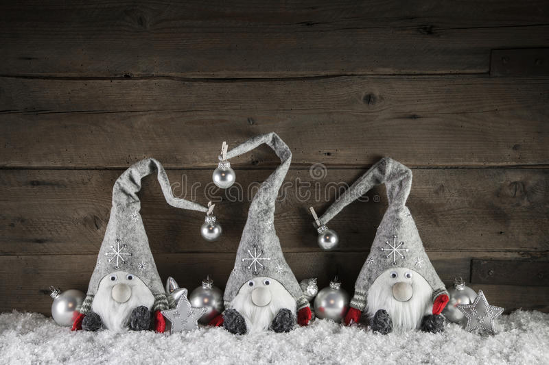 Three handmade gimps on wooden background for christmas decoration in country style. royalty free stock images