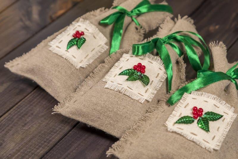 Three handmade sacks stock photography