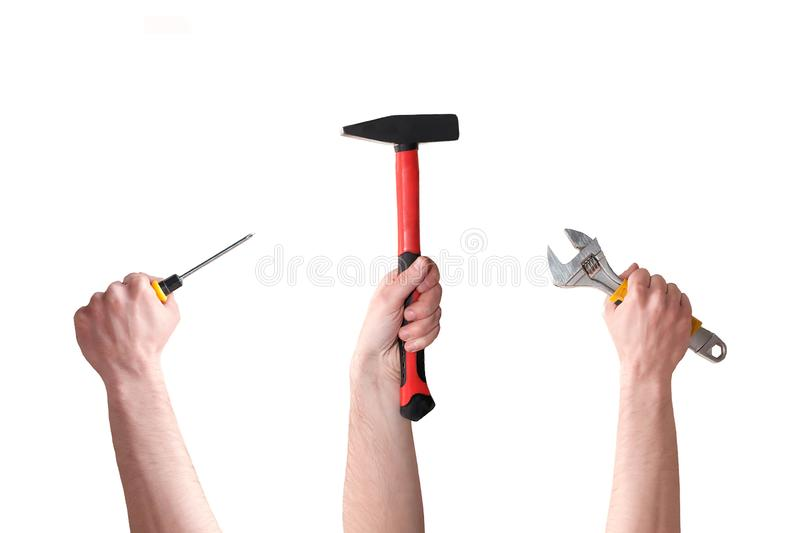 Three hands with screwdriver, hammer, and wrench on white background. Manual labor. Handmade and DYI. Building and repair stock image