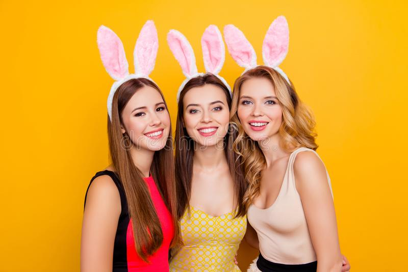 Three happy charming, pretty girls in dresses with hairstyle wea stock photography