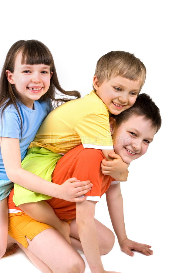 Three happy children playing. A family of happy children playing together, isolated on a white background royalty free stock images