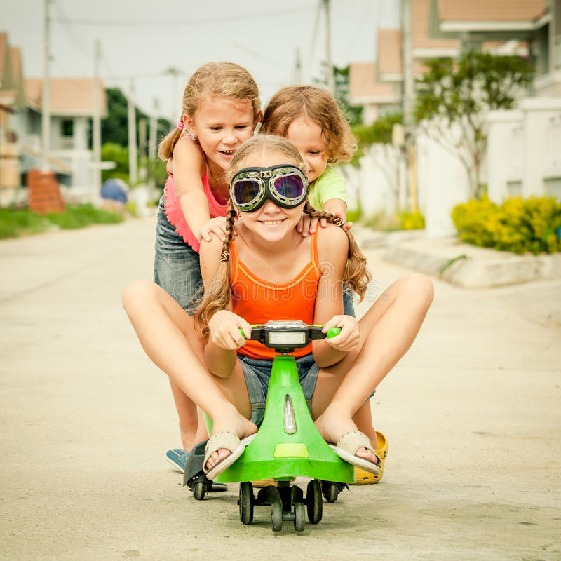 Three happy children playing on the road stock photography