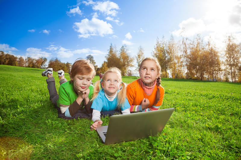 Three happy friends browsing outdoors royalty free stock photography