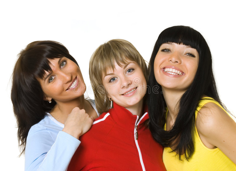 Three happy girls. Three happy girlfriends embrace on a white background royalty free stock photography