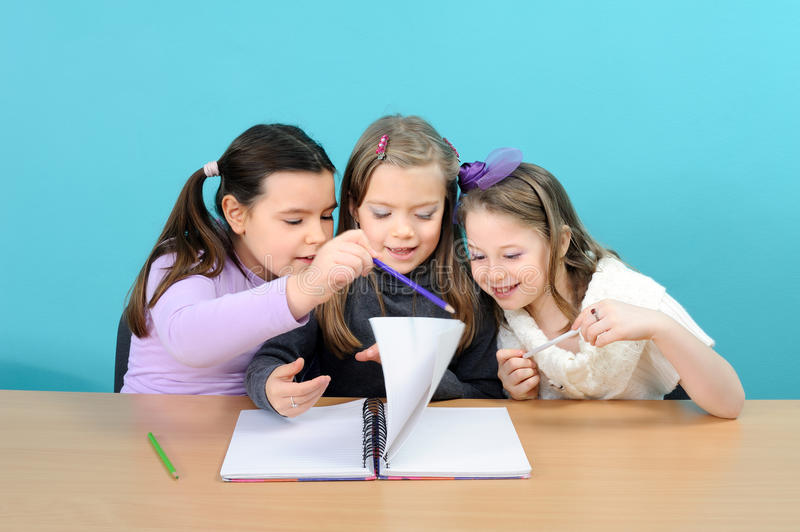 Download Three Happy Girls Doing Their School Work Stock Photo - Image: 22817266