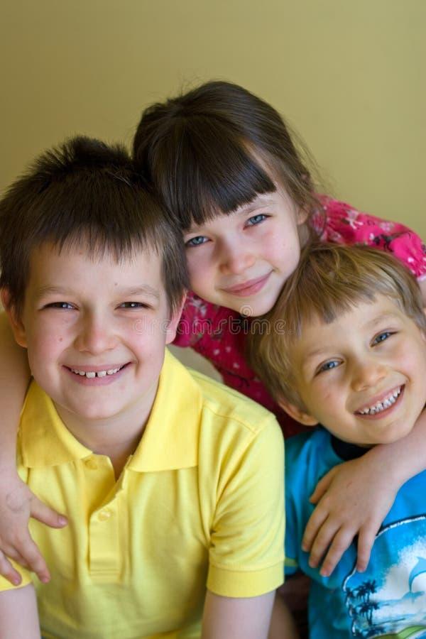 Three happy siblings stock photo
