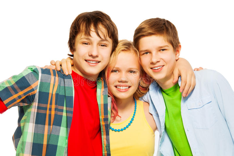 Three happy smiling and hugging teens smile stock photos