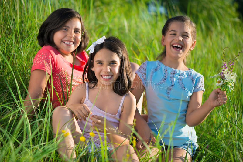Three happy teen girls at park royalty free stock images