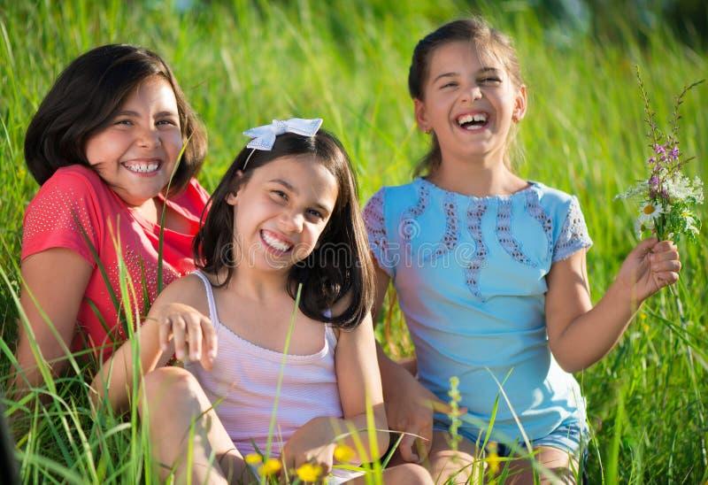 Three happy teen girls at park royalty free stock photo