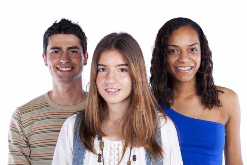 Three happy teenagers. Isolated on white stock photos