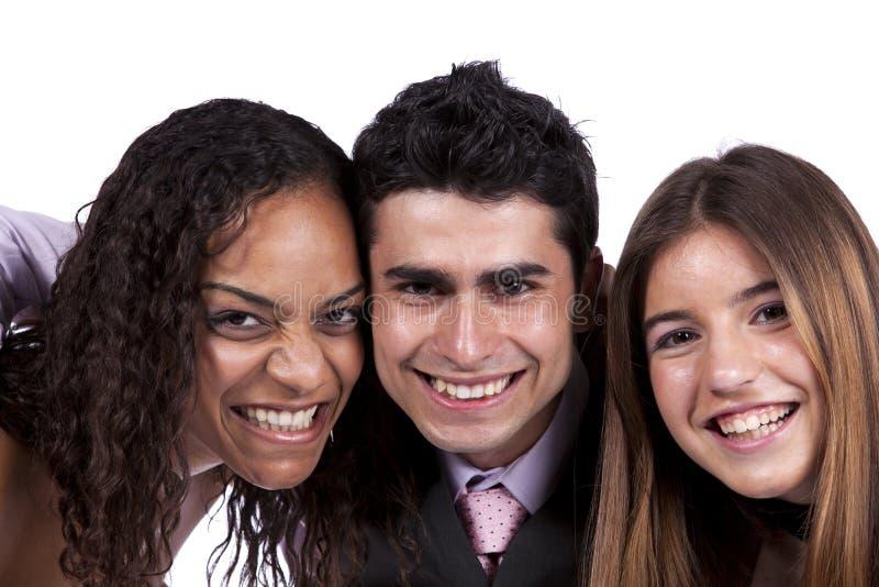 Three happy teenagers. Isolated on white stock photo