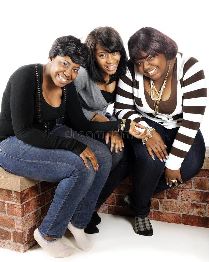 Three Happy Teens. Three older African American teens enjoying a laugh together stock image