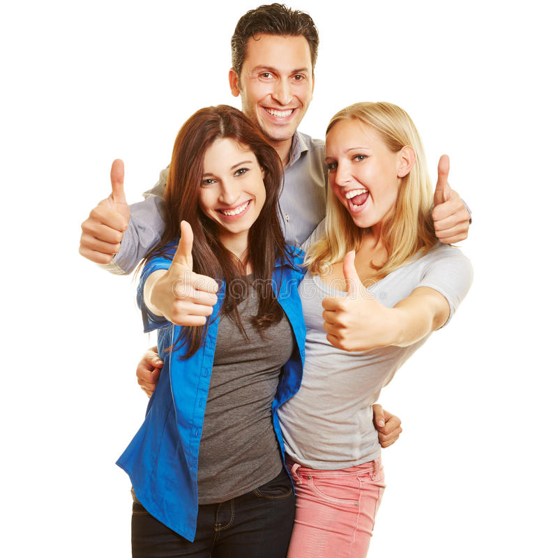 Three happy young people holding stock photo