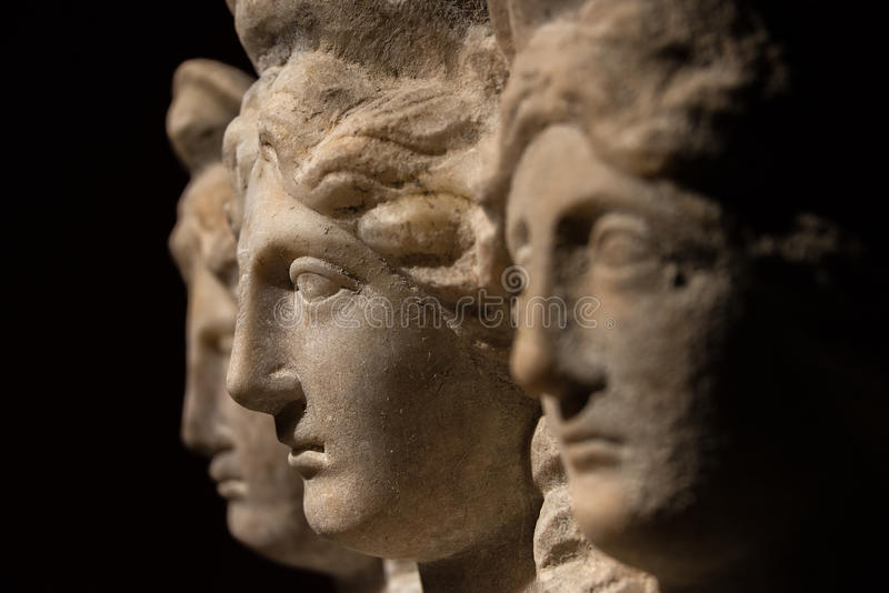 Three headed roman-asian ancient statue of beautiful women royalty free stock images