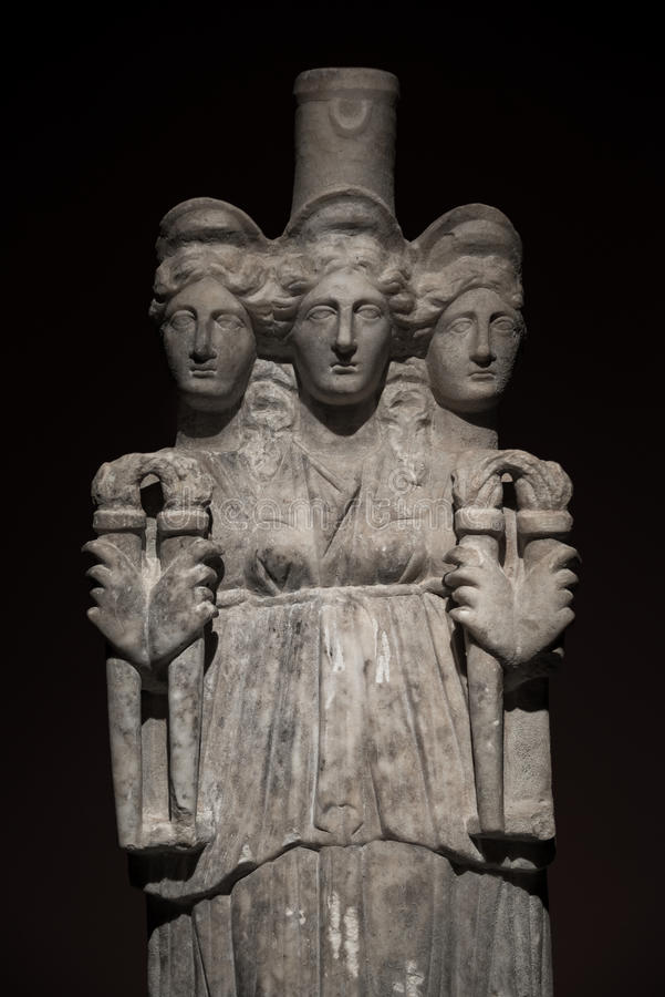 Three headed roman-asian ancient statue of beautiful women at bl stock photography