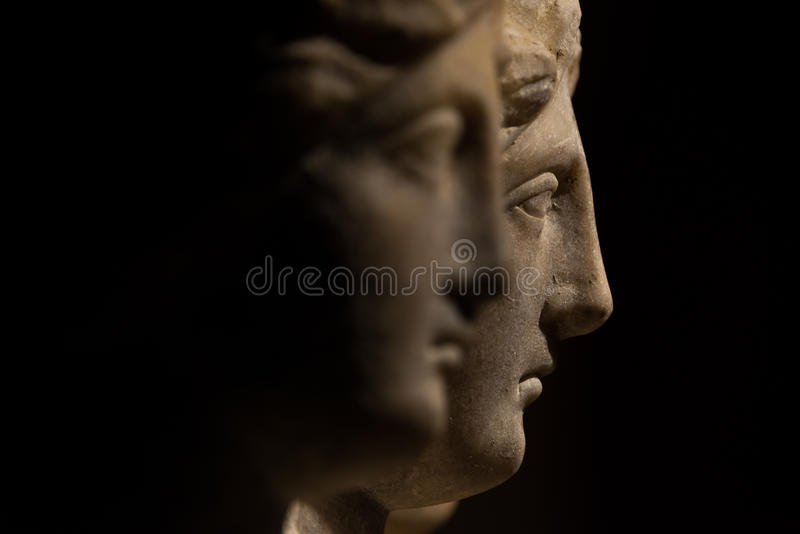Three headed roman-asian ancient statue of beautiful women, Goddess Hekate, black isolated royalty free stock photography