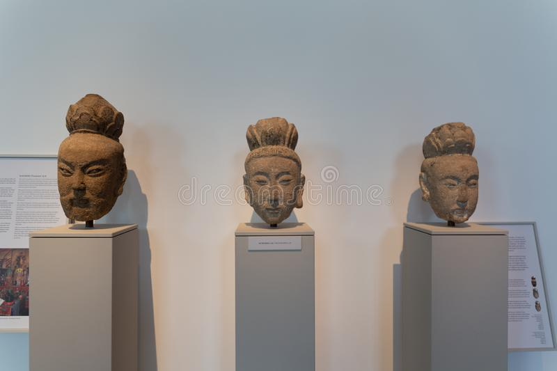 Three heads at the Ostasiatiska Museum of East Asia. Stockholm. Sweden 08.2019 stock photos