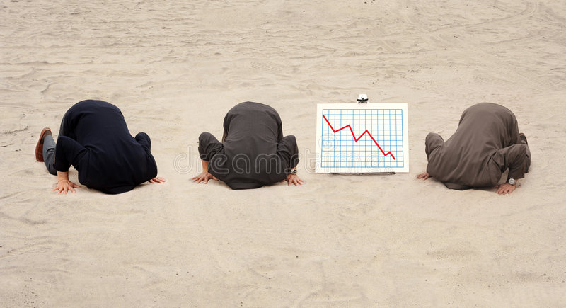 Three heads in the sand royalty free stock photography