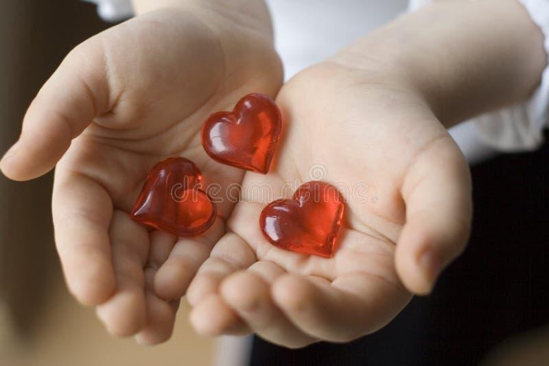 Three hearts stock photos