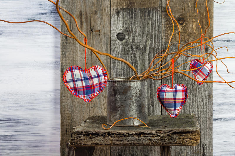 Three hearts hanging branches can royalty free stock photography