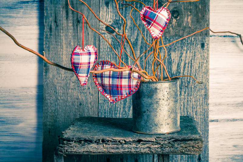 Three hearts hanging branches can stock image