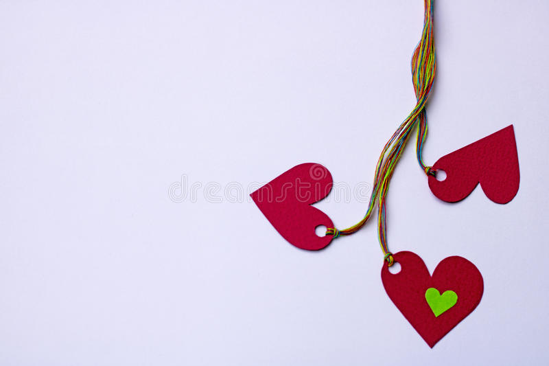 Three hearts linked colorful strings - on white background,copy space stock photos