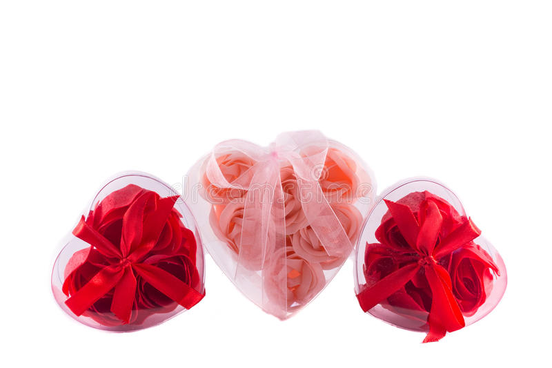 Three hearts from pink and red roses with bows royalty free stock images