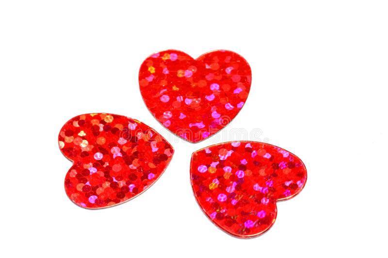 Three hearts. Three red hearts with reflective dots . Isolated on white background stock image