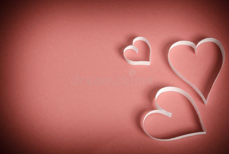 Three hearts of white paper stock photo