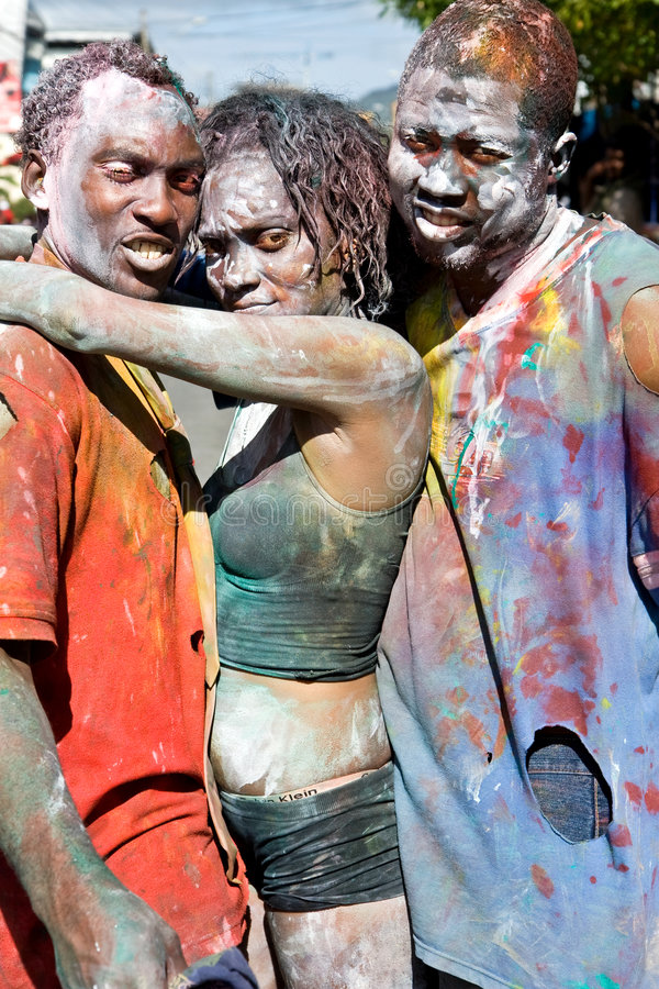 Three for heaven. After J'Ouvert celebrations during the 2008 Carnival season in Trinidad - costumed revellers with paint. J'ouvert is the raw heart of Trinidad stock photo