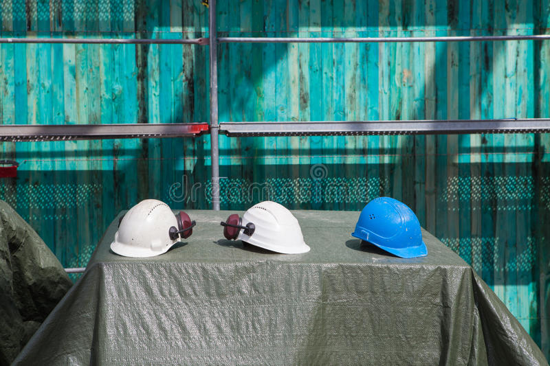 Download Three helmets stock photo. Image of blue, industry, muffs - 26347426