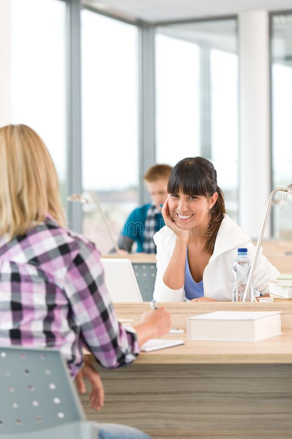 Three high school students in classroom stock image